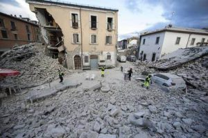 A general view of houses collpsed in Amatrice, central Italy, where a 6.1 earthquake struck just after 3:30 a.m., Wednesday, Aug. 24, 2016. The quake was felt across a broad section of central Italy, including the capital Rome where people in homes in the historic center felt a long swaying followed by aftershocks. ANSA/ MASSIMO PERCOSSI
